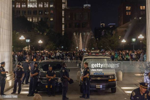 Police set up a perimeter beneath the archway of Washington Square Park on June 18, 2021 in New York City. The gatherings in the park have drawn...