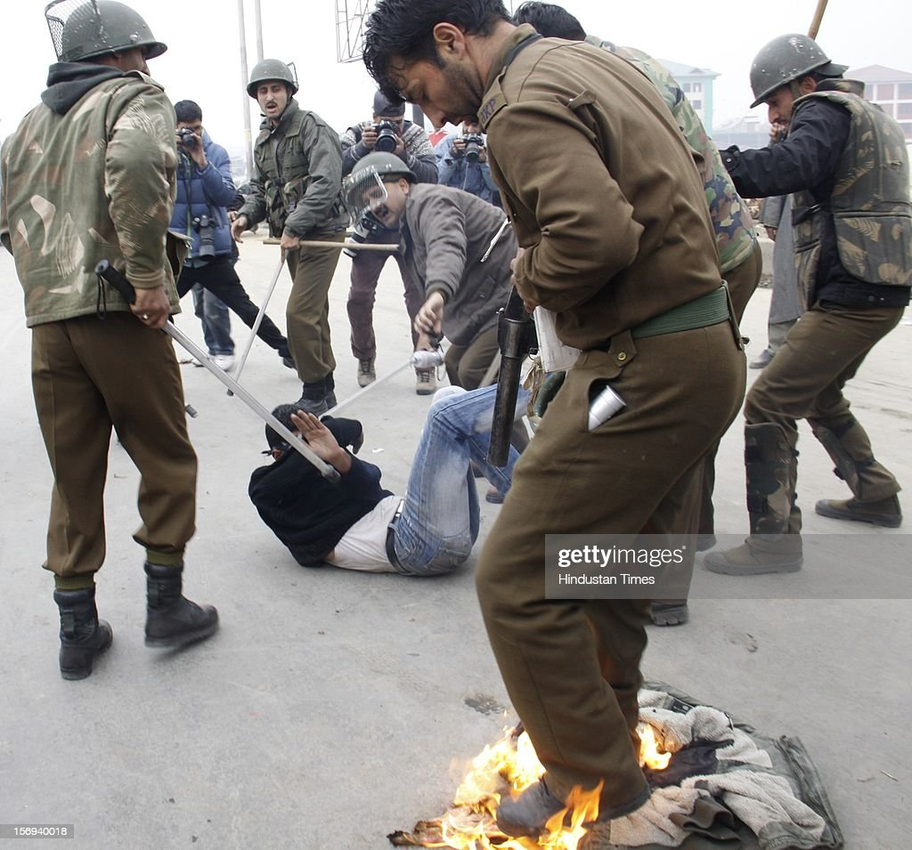 Police set upon a mourner during a procession from Batamaloo area in which several mourners got injured, on November 23, 2012 in Srinagar, India. Authorities have imposed severe restrictions to thwart Muharram procession in Srinagar. Police has erected barbed wire barricades on roads and deployed hundreds of police and paramilitary men to enforce the restrictions. Shiite Muslims all over the world mourn the slaying of Imam Hussein, grandson of Prophet Mohammad, during Islamic month of Muharram.