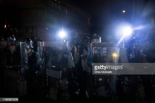 Police shine lights at protesters amid clashes after an antiextradition bill march on July 21 2019 in Hong Kong China Prodemocracy protesters have...