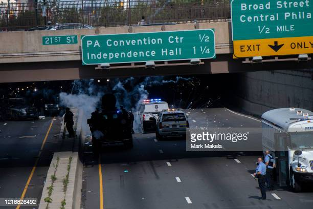 Police shoot tear gas into a crowd of protesters after a march through Center City on June 1 2020 in Philadelphia Pennsylvania Demonstrations have...