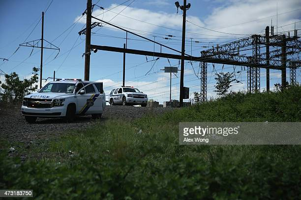 Police shut down a ramp that lead to a train track near the site of a train derailment accident May 13 2015 in Philadelphia Pennsylvania Service has...