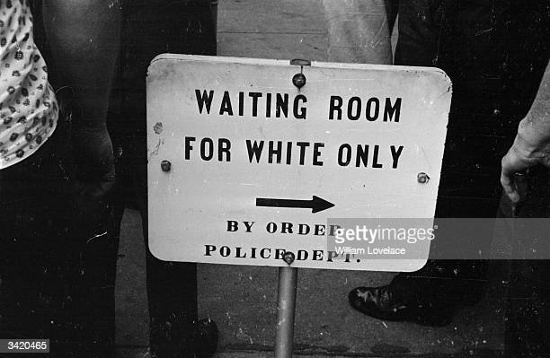A police sign for a 'white only' waiting room at the bus station in Jackson Mississippi