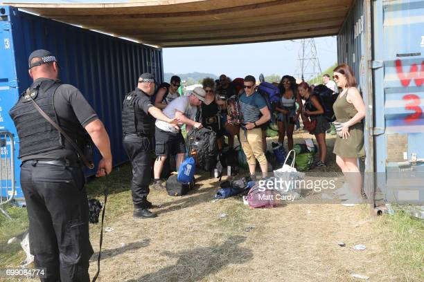 A police sniffer dog checks over festival goers bags as the gates open at the Glastonbury Festival amid heightened security at Worthy Farm in Pilton...
