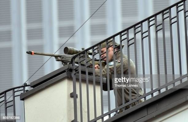 Police sniper guards the arrival of French President Emmanuel Macron and German Chancellor Angela Merkel for the opening of the Frankfurt Book Fair...