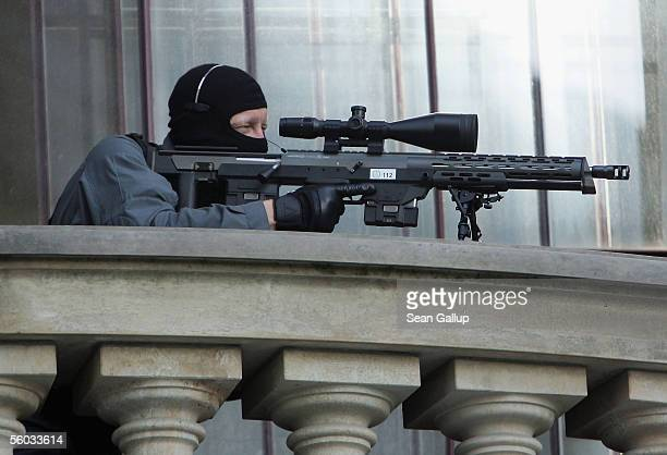 A police sniper keeps a watchful eye outside the completed Frauenkirche Cathedral October 30 2005 in Dresden Germany on the day of the cathedral's...
