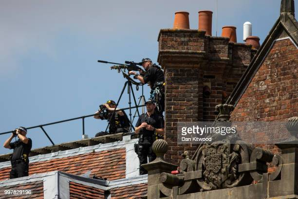 Police snipers keep watch as Prime Minister Theresa May and US President Donald Trump hold a joint press conference at Chequers on July 13 2018 in...