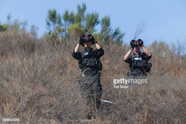 Police snipers set up in the hills above where the President will speak President Obama signed a declaration marking the mountains of San Gabriel in...