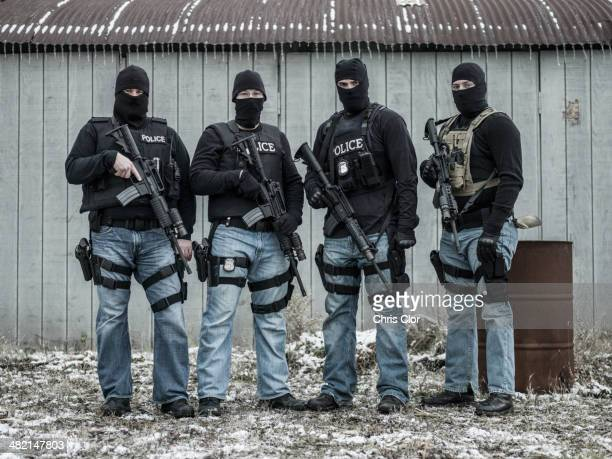 Police snipers standing together outdoors
