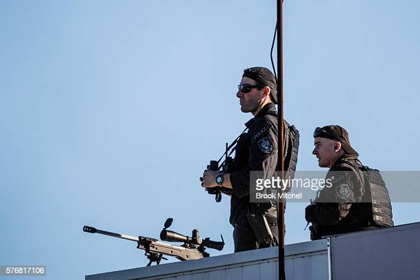 Police snipers watch over US VicePresident Joe Biden's arrival at Sydney Airport on July 18 2016 in Sydney Australia Biden is visiting Australia on a...