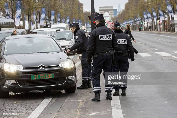 Police speak to a driver as they control traffic on the Champs Elysee during the United Nations COP21 climate summit in Paris France on Monday Nov 30...