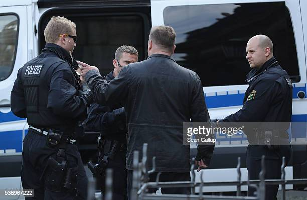 Police speak to a man they deemed as suspicious outside the venue of the 2016 Bilderberg Group conference on June 9 2016 in Dresden Germany Dresden...