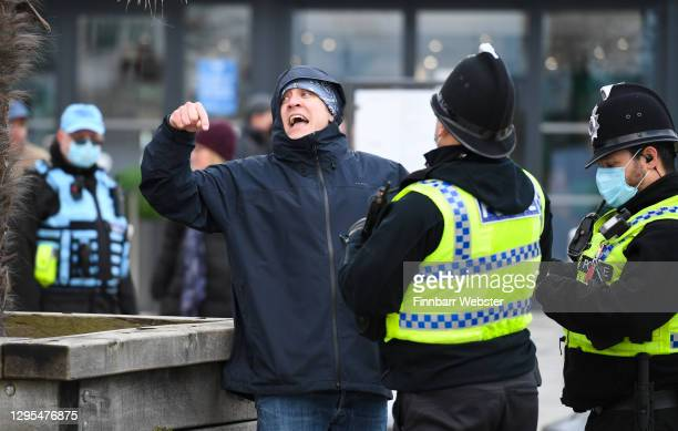 Police speak to a protester at the seafront on January 09, 2021 in Bournemouth, England. Chief Medical Officer Chris Whitty has filmed an advert for...