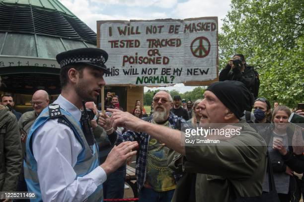 Police speak to a protestor as conspiracy theorists gather at Hyde Park Corner to defy the emergency legislation and protest their claim that the...