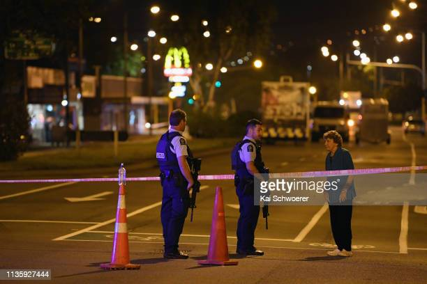 Police speak to a resident as they cordon off Linwood Avenue near the Linwood Masjid on March 15 2019 in Christchurch New Zealand 49 people have been...