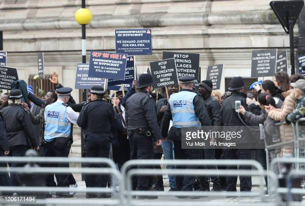 Police speak to protesters before the Commonwealth Service at Westminster Abbey London on Commonwealth Day The service is the Duke and Duchess of...
