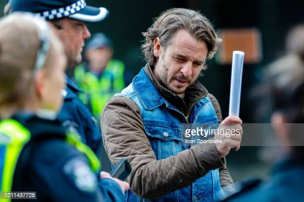 Police speak with protesters from the St Kilda Rebellion as they stand against the lockdown laws in Acland Street St Kilda during COVID19 on 01 May...