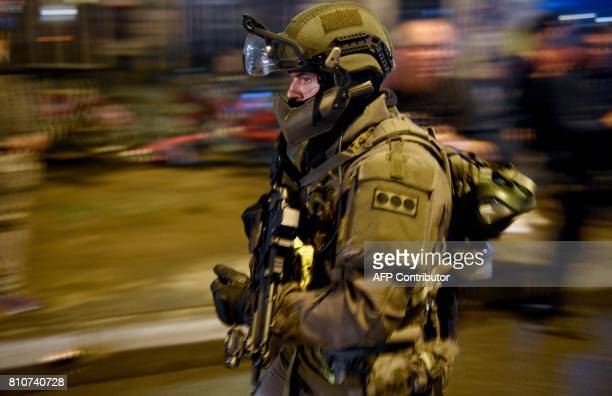 A police special commandos unit SEK patrol during riots on July 7 2017 in Hamburg northern Germany where leaders of the world's top economies gather...