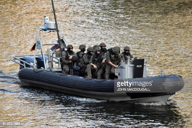 A police special commandos unit SEK patrols by boat on the Elbe river a concert at the Elbphilharmonie concert hall during the G20 Summit in Hamburg...
