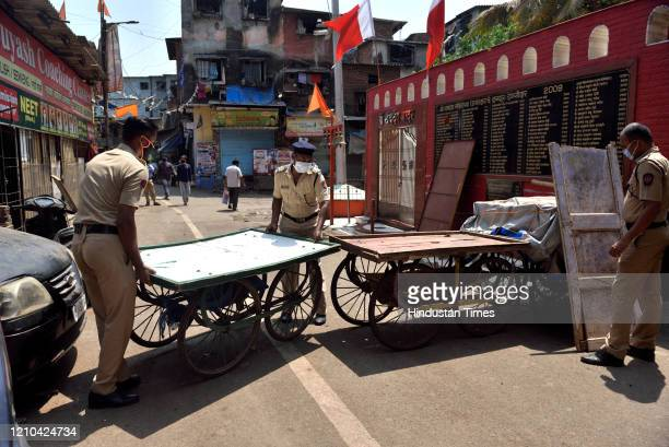 A police special force block the road at Dharavi suspected area during the nationwide lockdown imposed in the wake of the coronavirus pandemic on...