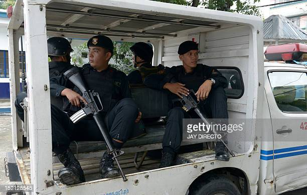 A police Special Weapons And Tactics team leaves the police headquarters to patrol the streets of Manila on September 17 2012 The Philippines'...