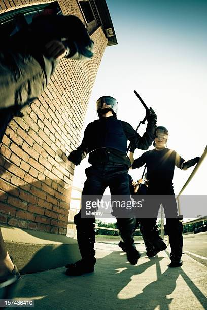 police squad chasing rioter - civil disobedience movement stock pictures, royalty-free photos & images