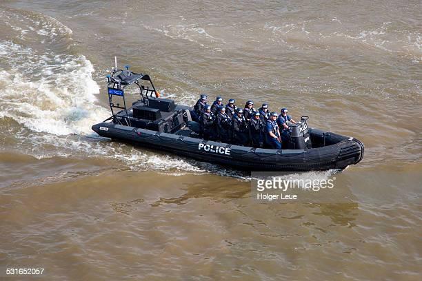 Police squad in Zodiac boat on Thames river