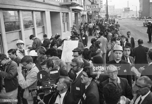 Police squad wedged through a line of 2,500 anti-draft pickets to arrest this group staging a sit-in at the entrance to the Oakland Induction center....