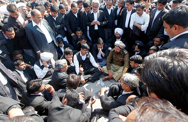 Police SSP Operation RS Ghuman and advocates during negotiation near Punjab Raj Bhawan on March 6 2013 in Chandigarh India Lawyers of Punjab and...