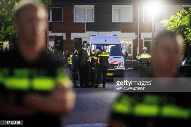 Police stand after a shooting incident in which several victims were killed, on the Heimerstein in Dordrecht, on September 9, 2019. - At least three...