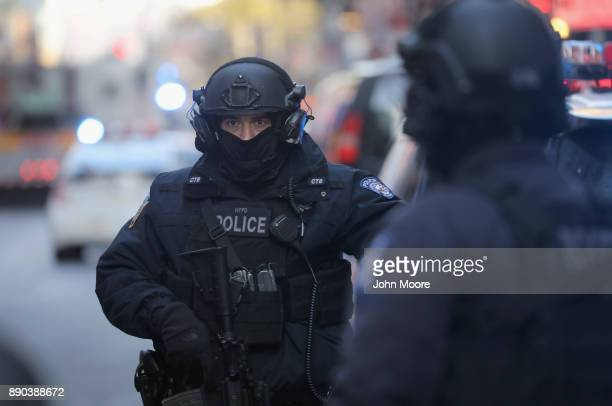 Police stand along 42nd Street in Midtown Manhattan near the site of a pipe bomb explosion on December 11 2017 in New York City Police said that...