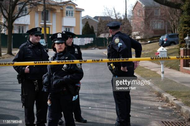 "Police stand along the street where reputed mob boss Francesco ""Franky Boy"" Cali lived and was gunned down on March 14 2019 in the Todt Hill..."