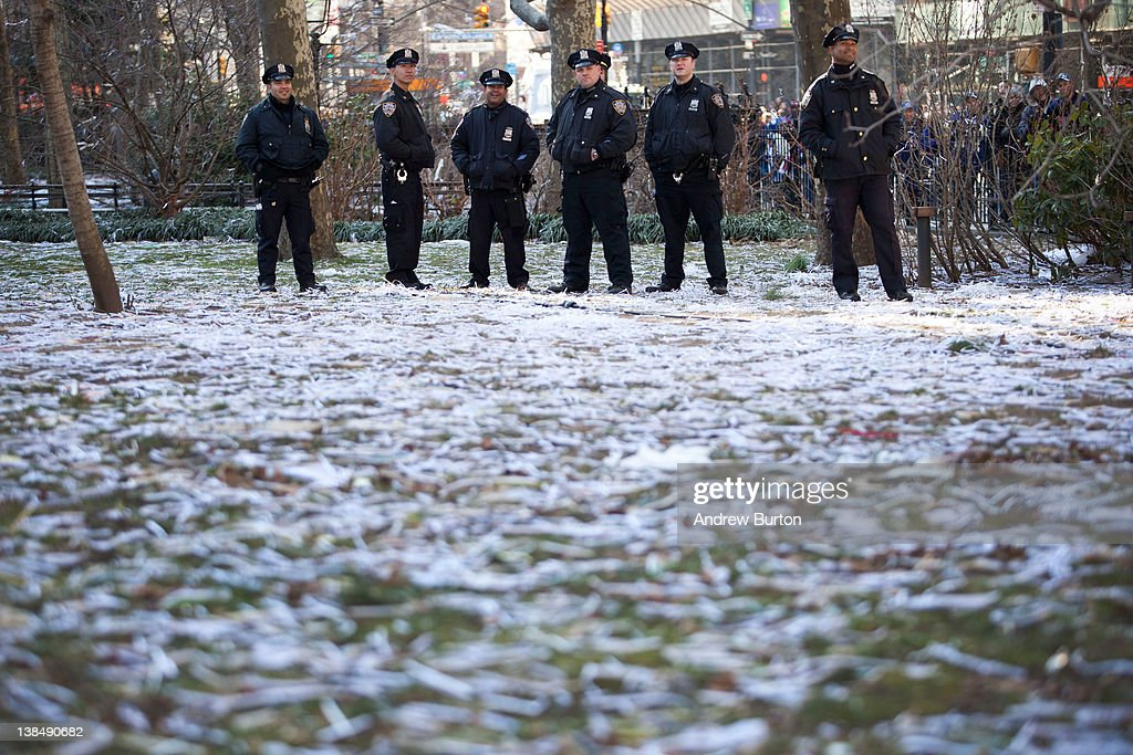 Police stand amongst a field of ticker tape during The New York Giants' Victory Ceremony at City Hall on February 7, 20122012 in New York City. The Giants defeated the New England Patriots 21-17 in Super Bowl XLVI on Sunday, February 5, 2012.