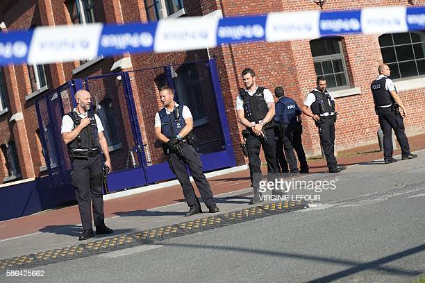 TOPSHOT Police stand as they secure the area around a police building in the southern Belgian city of Charleroi following a machete attack on August...