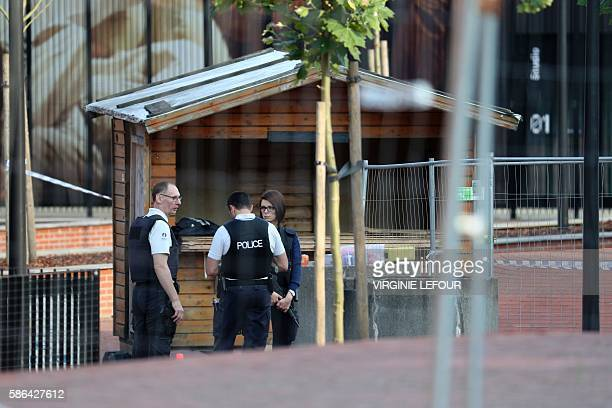 Police stand as they secure the area around a police building in the southern Belgian city of Charleroi following a machete attack on August 6 2016 A...