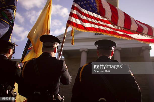 Police stand at attention during funeral services for James Zadroga a former New York City police detective who worked hundreds of hours at World...