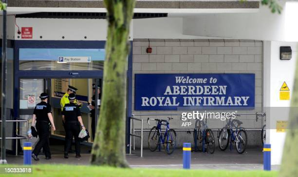 Police stand at the entrance to the Aberdeen Royal Infirmary in Aberdeen where Britain's Prince Phillip is being treated for a bladder infection The...