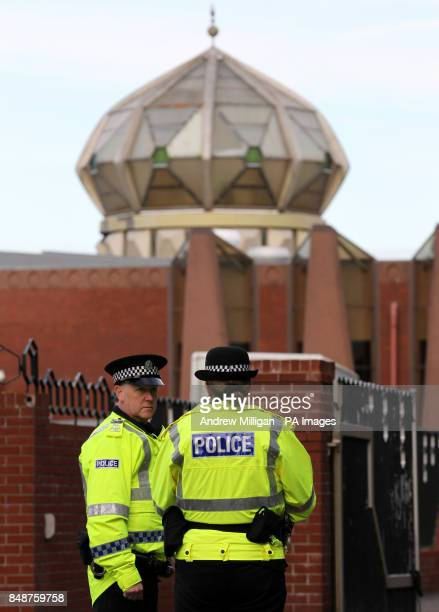 Police stand at the gates of Glasgow Central Mosque after the funeral of Fazal Ahmad as hundreds of mourners gathered for the funeral of the...
