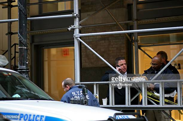 Police stand at the scene on 158 Mercer St where Mark Madoff son of Bernard Madoff was found dead of an apparent suicide by hanging December 11 2010...