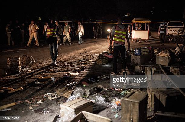 Police stand at the site of a grenade explosion in Antananarivo's Anosy district on January 25 just hours after the island's newly elected postcoup...