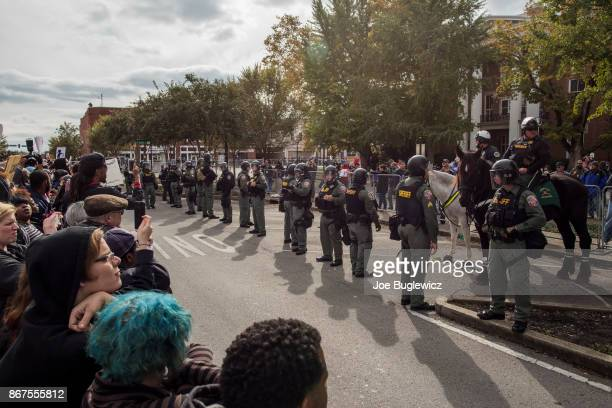 Police stand between protestors during a White Lives Matter rally on October 28 2017 in Murfreesboro Tennessee Tennessee Gov Bill Haslam said state...