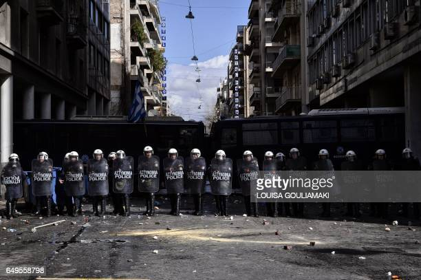 TOPSHOT Police stand by a blockade during a Greek farmer's protest against higher taxes outside the Agriculture ministry in Athens on March 8 2017...