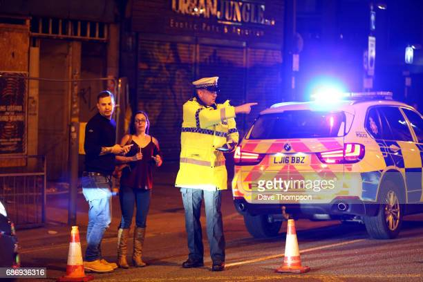 Police stand by a cordoned off street close to the Manchester Arena on May 22, 2017 in Manchester, England. There have been reports of explosions at...