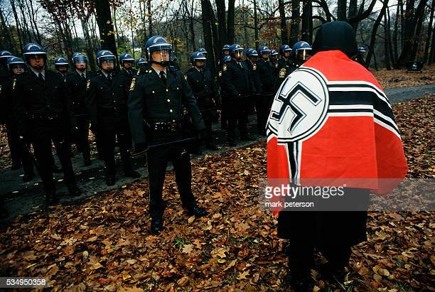 Police stand by as a member of the United States of America Nationalist Party a neoNazi group attends a protest in New Hope Pennsylvania Members of...