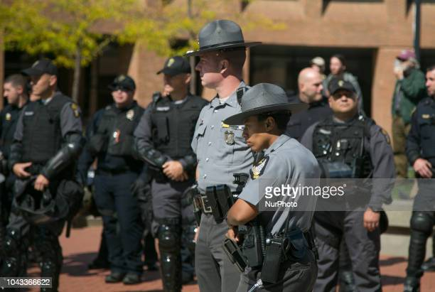 Police stand by during an open carry rally at Kent State University in Kent Ohio on September 29 2018