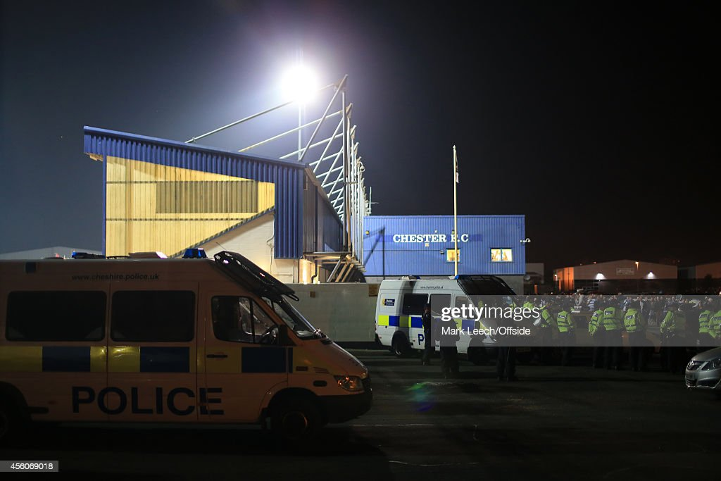 Police stand by outside the ground after the Vanarama Conference match between Chester and Wrexham at the Deva Stadium on September 22, 2014 in Chester, England.