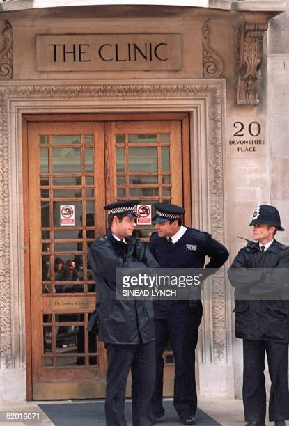 Police stand guard 19 October at the entrance to The London Clinic hospital where former Chilean dictator Augusto Picochet is believed to be...