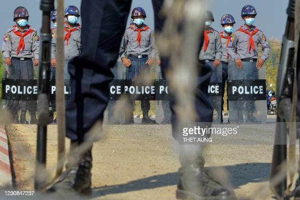 Police stand guard along a road in Naypyidaw on January 29 ahead of the reopening of the parliament on February 1 following the November 2020...