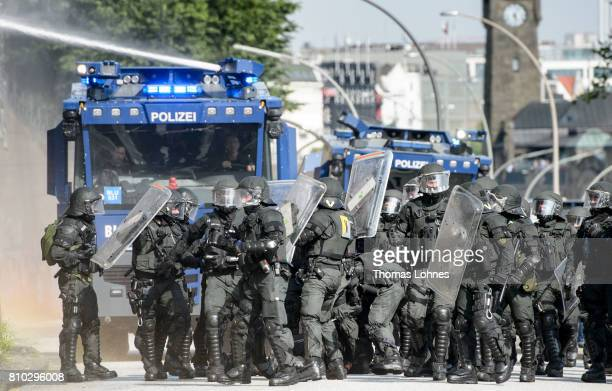 Police stand guard around an injured police officer during the anti G20 Summit demonstration near Hamburg on July 7 2017 in Hamburg Germany Leaders...
