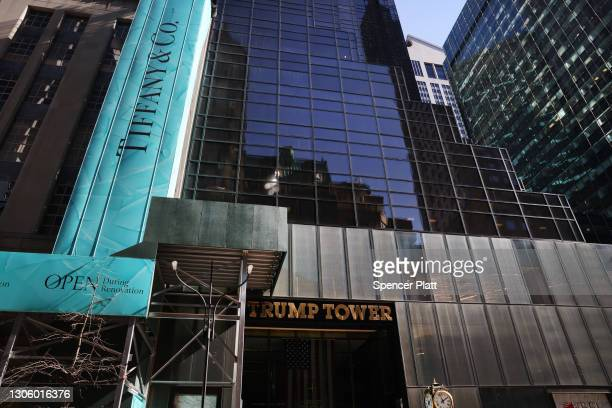 Police stand guard as a small group of supporters of former president Donald Trump hold a rally in front of Trump Tower on March 08, 2021 in New York...