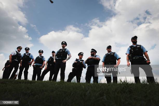 Police stand guard as demonstrators prepare to protest on Lakes Shore Drive during rush hour on August 2 2018 in Chicago Illinois The demonstrators...